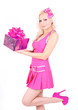 blonde girl in pink dress holding Christmas gift box isolated