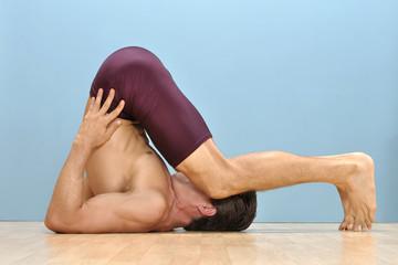 Karnpirasana yoga position
