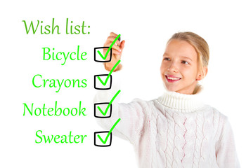 Girl writing a wish list over a white background