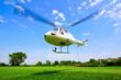Leinwandbild Motiv Hubschrauber Start vor blauem Himmel