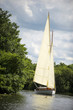 Norfolk Broads sail boat sailing on a river - 47279554