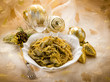 spaghetti carbonara with artichoke on christmas table