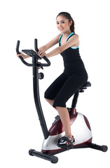 A pretty woman training on exercise bike