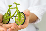 hand holding green bicycle icon