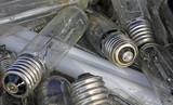 broken bulbs in a landfill of waste
