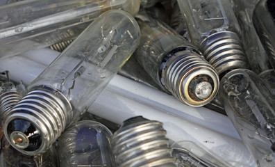 broken bulbs in a landfill of waste