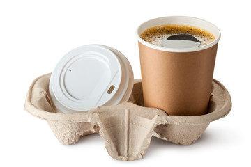 Opened take-out coffee in holder. Lid is near.
