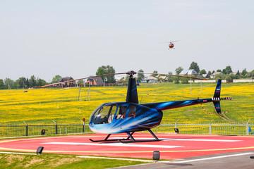 Helicopter Robinson on helipad