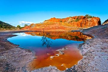 Small mineral lake in Rio Marina, Elba Island, Italy.