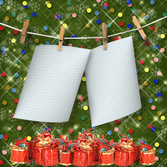 Greeting card hanging on a rope and clothespins  with presents o