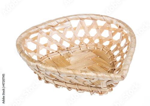 Wickerwork empty yellow breadbasket on white background