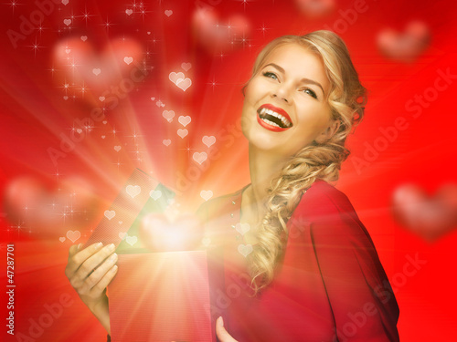 lovely woman in red dress with valentine gift box
