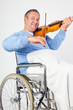 Man in wheelchair playing violin