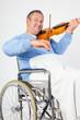 Man in wheelchair playing violin