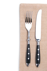 fork and knife on a flax napkin