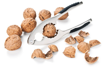 walnuts and nutcracker isolated on white