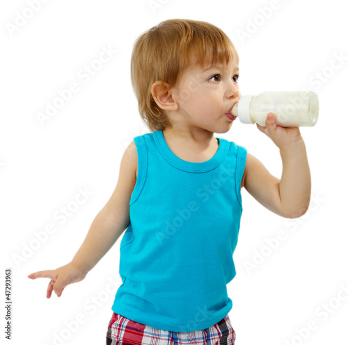 cute little boy with bottle of milk, isolated on white