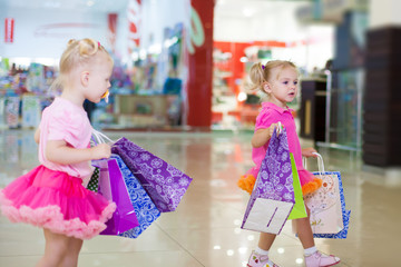 little girls in a big shopping center