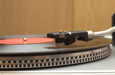 Turntable  and vinyl record with red label closeup