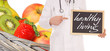 fresh fruit and doctor with sign - healthy living