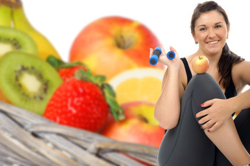 sporty woman and fresh fruits