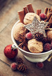 Walnuts, spices and christmas decor in a cup