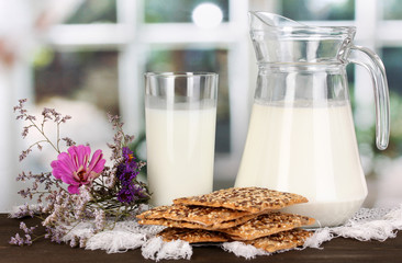Pitcher and glass of milk with cookies