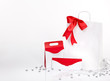 gift bag and envelope with red ribbon an white background