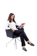 Casual 20s women reading newspaper, focused
