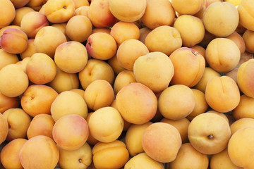 Many Peaches at a Market
