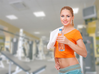 Young woman on fitness club