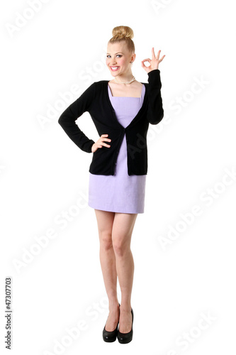 Female with okay gesture, isolated on white.