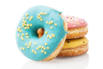 Three glazed donuts isolated on white background