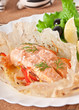 Baked salmon with vegetables in an envelope