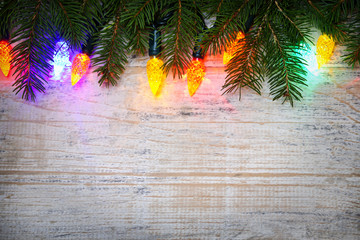 Christmas background with lights on branches