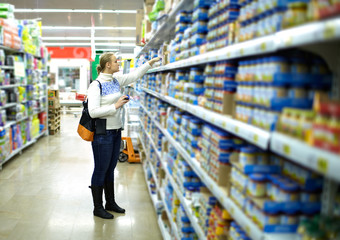Woman in the supermarket. Kid's food.