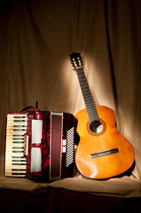 Retro accordion and acoustic guitar