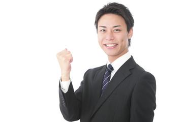ガッツポーズの若いビジネスマン