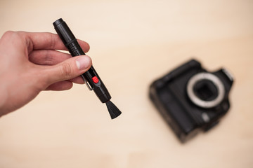Cleaning digital camera with brush