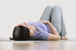 Portrait of a young fitness woman lying on a yoga mat and exerci