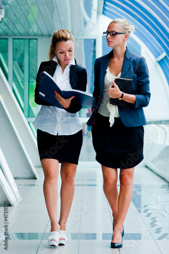 Two young and beautiful business women