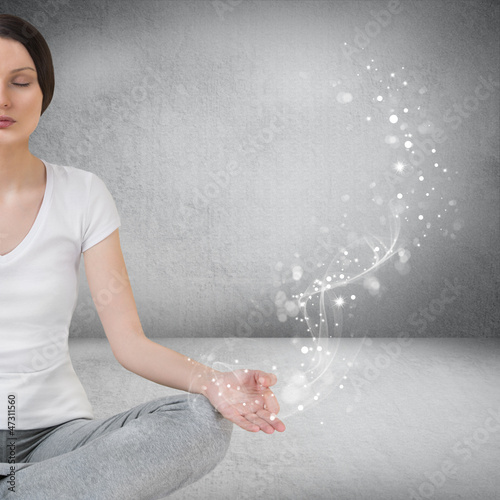 Pretty young woman meditating in empty room and graphic smoke, g