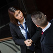 Businessman and business woman talking