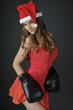 christmas beautiful girl wearing boxing gloves