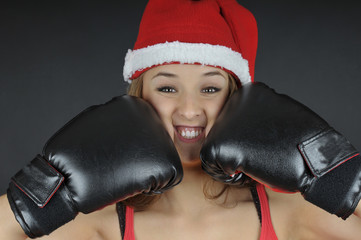 christmas funny girl wearing boxing gloves