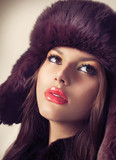 Beauty Fashion Model Girl in a Fur Hat