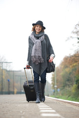 Happy Travel Woman at Train Station