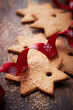 Gingerbread cookies with brown sugar on wooden surface