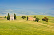 Tuscany landscape with chapel on a hill in Val d'Orcia, Italy