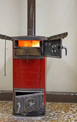 red wood stove on to heat the ancient villa of Count